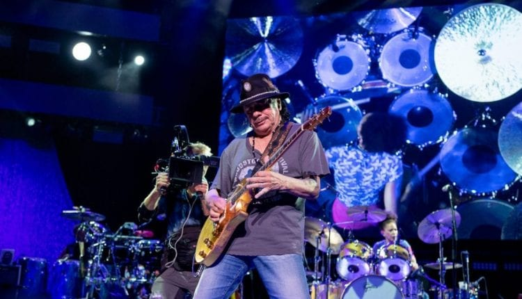 Carlos Santana performs at The Bethel Woods Center for the Arts on the 50th Anniversary of the day he played at Woodstock in 1969, bringing along tourmates The Doobie Brothers.